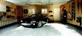garage makeover with slatwall panels added to all walls for ultimate storage solution
