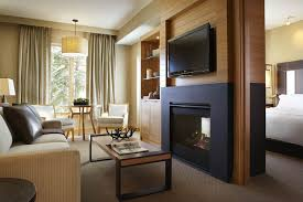 Bedroom:Breathtaking The Two Way Gas Fireplace Features Matching Flat  Screen TV Above It In
