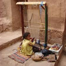 carpet loom. carpet loom and works for little pay food. this is extremly unfare, because she faces the danger of severly inguring herself from sharp u