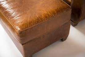 leather armchair and ottoman made by mitchell gold especially for restoration hardware