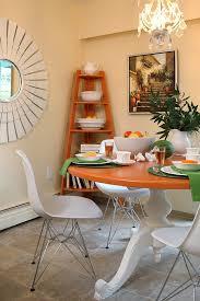 ... Freestanding corner bookshelf in the dining area [Design: Maria Killam]