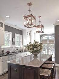 White Cabinets Grey Walls Neutral Backslash Dark Island Design By Carolina Design Associates Kitchen Inspirations Kitchen Design Sweet Home