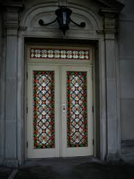 a stained glass door is topped with a beautiful matching transom window we provide stained