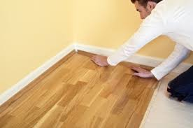 step 1replacing a damaged laminate floor plank close to a wall