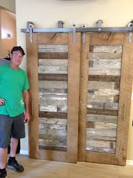 reclaimed oak and pabst blue ribbon factory floor bypass sliding with barn door style closet doors