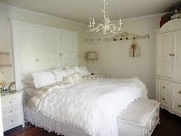 choosing chandeliers in bedrooms cozy classic bedroom decoration using blanket and pillows also bedside table
