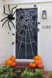 Spider Web Door via Catch My Party | Frighteningly Fabulous Halloween Door  Decor Ideas