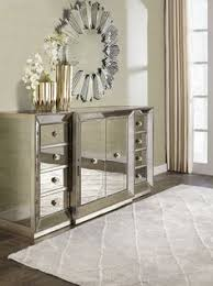 omni mirrored buffet bines glamour with purpose the clean lines of the cases are outlined in a hand applied silver leaf and silver beaded trim while