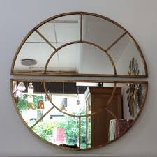 large round wall mirror with 2 oval sections