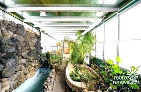 tiny home with greenhouse attached to unique deck pergola