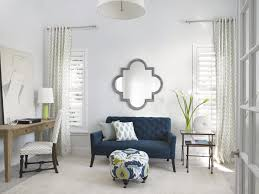 white airy home office. the home office is a light airy space that promotes creative thinking blue white n