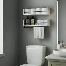 beautiful white shelves in the bathroom over the toilet looks stunning with that paint color