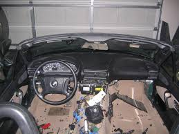 z3 diy how to replace your entire interior 12 next you ll need to remove the rear console a remove the subwoofer lid b unscrew unplug and carefully remove the subwoofer