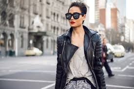 leather jacket layered over knitwear