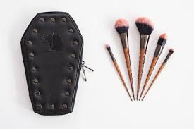 themed makeup brushes. the set comes with five halloween-themed brushes aptly named headless whore, devil in disguise, skincrawler, bloody-hell, and freak or unique. themed makeup