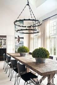 long island retreat designer mark epstein antique belgian oak trestle table paired with modern clic klismos chairs by donghia