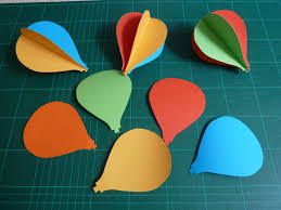 draw a template in cardboard of your hot air balloon and use to cut out the shape in five diffe coloured cards
