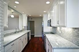 what color granite with white cabinets and dark wood floors
