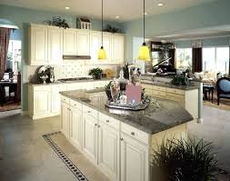 kitchen floors with white cabinets these stunning granite counters go well with the off white cabinetry