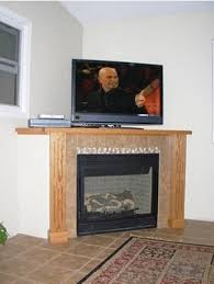 simple design corner foreplace with tv above corner fireplace tv stand entertainment center