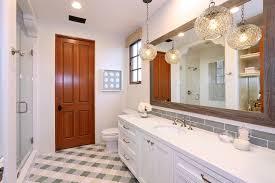 mirror frame decorating ideas bathroom terranean with bathroom light fixtures sand dollar artwork spanish architecture