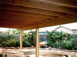 a solid roof patio cover under construction wood covers wooden ideas are still the best choice trellis style patio cover attached to house wood