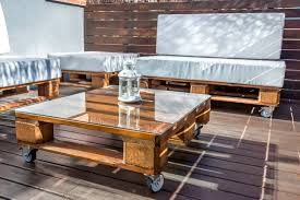 simple square natural wood pallet coffee table for the deck on wheels