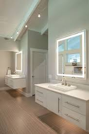 dual vanities in master bathroom with lighting underneath for night time by nest design