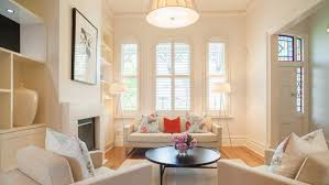 a warm white was used to freshen the look of this period home