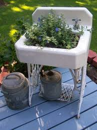 old sink for a planter they use an old sewing machine as the base