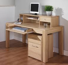 furniture ivory wooden standing desk with shelf and drawers also keyboard rack on laminate flooring