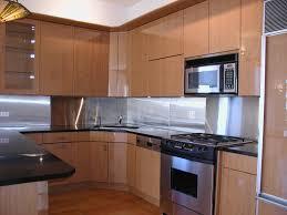 astounding metal backsplash with brown wall mount cabinet and dark laminate flooring