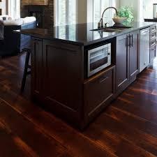 dark oak hardwood floors. Rustic Modern Kitchen Design With Wide Plank Distressed Oak Hardwood Flooring Tiles And Dark Brown Island Microwave Storage Black Marble Countertop Floors