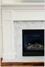 carrara marble tile fireplace surround