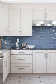 white cabinets blue backsplash white and blue kitchen features white cabinets adorned with satin