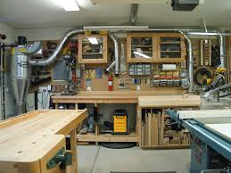 garage workshop. the east wall. my cyclone dust collector, drill, miter saw and sanding equipment air tools. larger tools like planer, mortiser belt/disc sander garage workshop