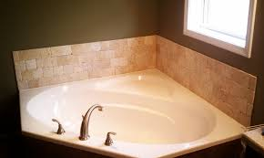 tile bathtub surrounds with brown wall and brizo faucet for bathroom design