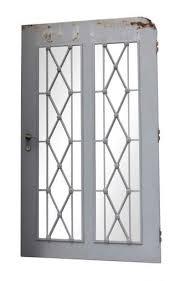 late century steel doors with diamond lattice design
