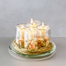 a set of four 3 75 inch tealight votive candleholders on a glass candle plate