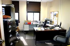 managers office design. Black Shelves On The Grey Floor With Brown Table It Also Has Minimalist Windows Warm Interior Design Managers Office