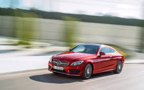 The front and rear seats are covered in a choice of black, red, saddle brown or ivory white leather. Mercedes Benz Reveals The New C Class Coupe The Car Guide