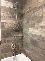 Very rustic shower with the wood looking porcelain tiles on the walls. We  have many