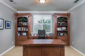 traditional custom home office. traditional home office with carpet custom cabinetry flush light crown molding