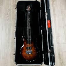 Home / guitars / electric guitars / premium guitars / john petrucci majesty tiger eye. Ernie Ball Music Man John Petrucci Majesty Tiger Eye