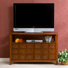 Short Media Cabinet Light Brown Wooden Cabinet With Many Small Drawers Combined With