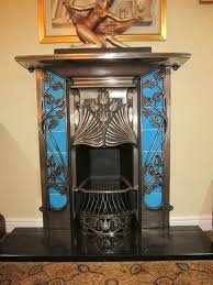 art deco blue fireplace with ginkgo leaves gorgeous