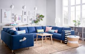 A light living room with a big U-shaped sofa for 9 people, covered