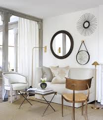 mismatched mirrors over sofa