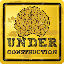 fissures abstract illustration of a human brain with under construction text over grunge yellow background