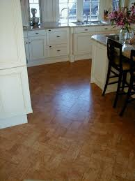white cabinets and cork floor in herringbone pattern gives this kitchen a polished look